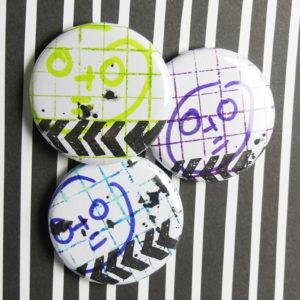 Lot de 3 badges «La Tête à Toto» de Quiscrap